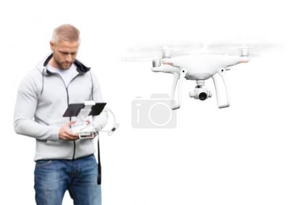 Photo for Young Man Operating Drone On White Background - Royalty Free Image
