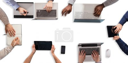 Photo for High Angle View Of Businesspeople Hand Working On Electronic Devices - Royalty Free Image