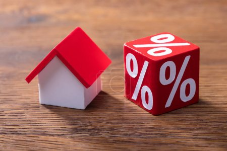 Close-up Of House Model And Percentage Red Block On The Wooden Table