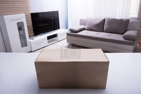 Close-up Of Cardboard Box On White Desk In Living Room