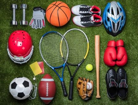 Photo for High Angle View Of Various Sport Equipments On Green Grass - Royalty Free Image