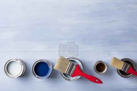 Photo for High Angle View Of Paint Can With Paintbrush On Wooden Plank - Royalty Free Image