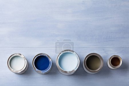 High Angle View Of Paint Can On Wooden Plank