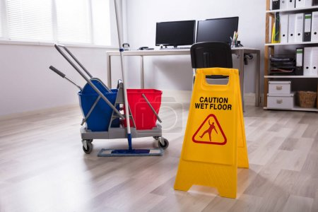 Wet Floor Caution Sign And Cleaning Equipments On Floor