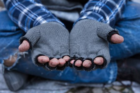 Close-up Of A Beggar's Dirty Fingers Wearing Glove...