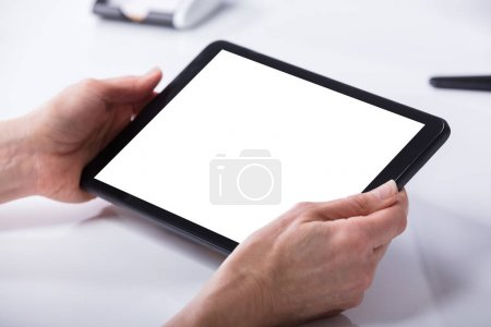 Woman's Hand Using Digital Tablet With Blank White Screen