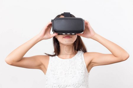 Photo for Woman watching though virtual reality glasses - Royalty Free Image