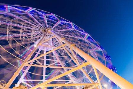 Ferris Wheel at amusement park during evening