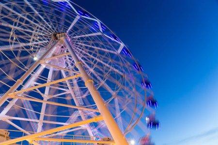Ferris wheel moving at night
