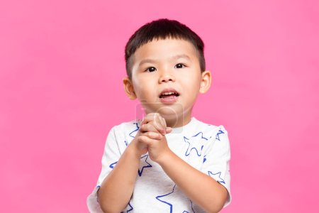 Little asian boy praying