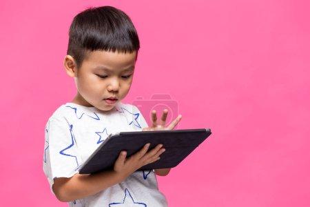 Little boy using tablet computer
