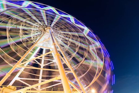 Photo for Ferris wheel moving at night - Royalty Free Image