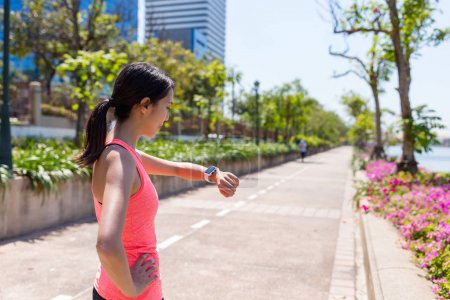 Sport woman looking at smart watch