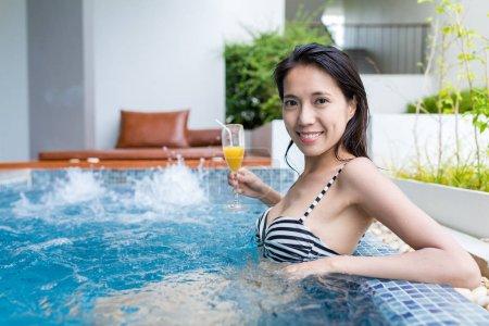 Woman enjoy juicy in jacuzzi pool