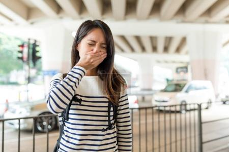 Woman feeling unwell with air pollution at outdoor