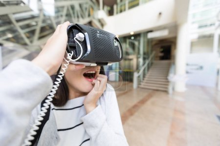 Woman feeling scared when using virtual reality