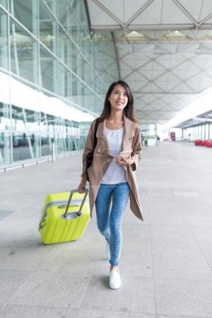 Woman walking in international airport