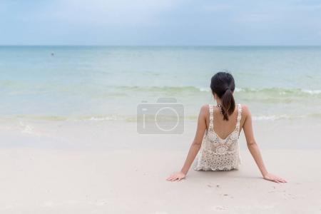 Woman relaxing on sand beach