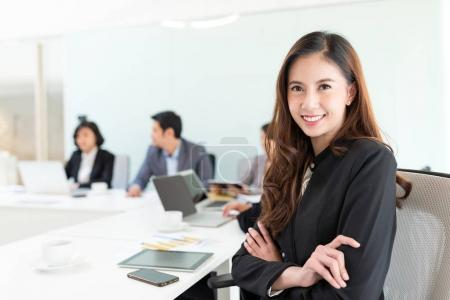 Young businesswoman in conference room