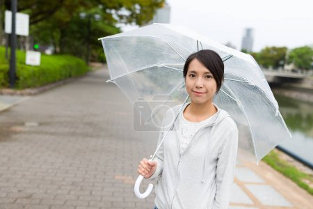 Woman going out in rainy day