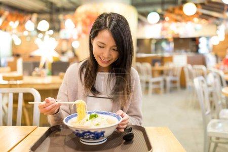 Woman enjoy her japanese noodles
