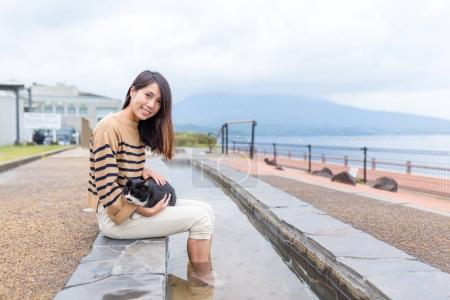 Woman enjoy her foot onsen at outdoor
