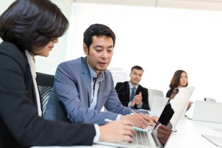 Business people working in meeting room