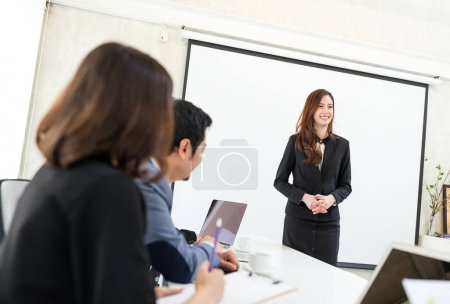 Businesswoman present her project inside meeting room