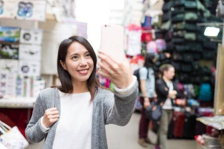 Woman travelling in Hong Kong and taking selfie