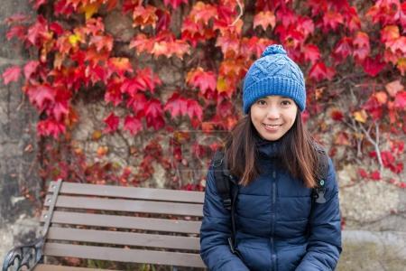 Woman in autumn season with maple trees