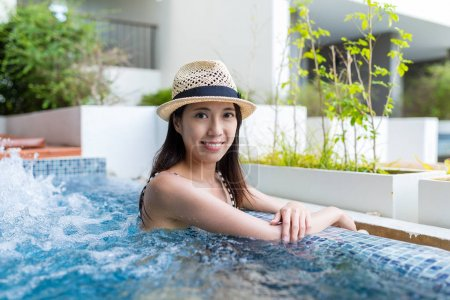 Woman enjoy in jacuzzi spa