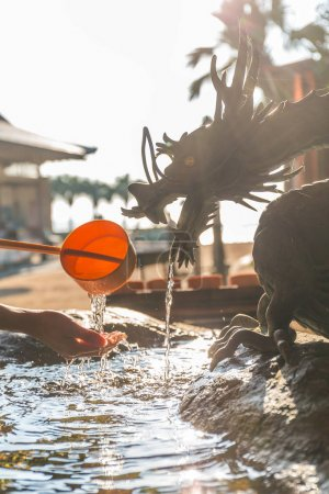 Bamboo water fountain with dragon statue