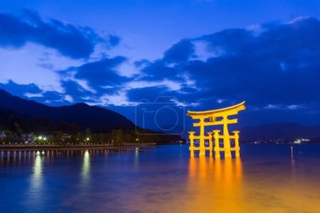 Torii in Itsukushima shine during sunset