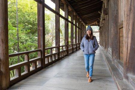 Woman walking in japanese wooden house