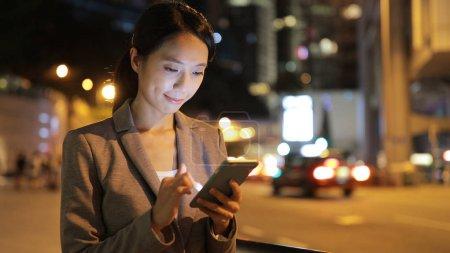 Businesswoman using cellphone