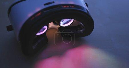 Virtual reality device playing movie at night