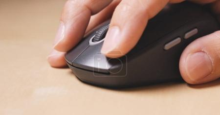 Person using a computer mouse
