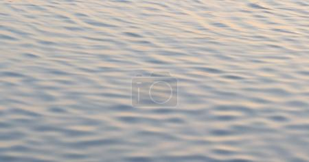 Water surface with a beautiful bokeh of sun glares