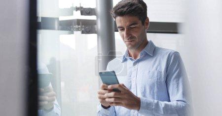 Man look at mobile phone