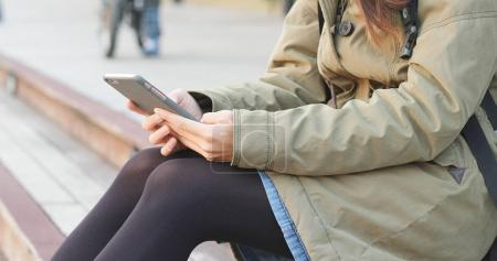 Photo for Woman sending sms on mobile phone - Royalty Free Image