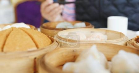 Eating steamed chinese dim sum