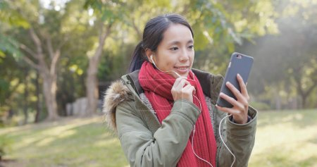 Woman talking on smartphone at park