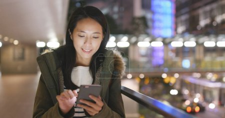 Asian Woman using cellphone in Hong Kong
