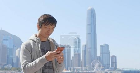Man using cellphone in Hong Kong