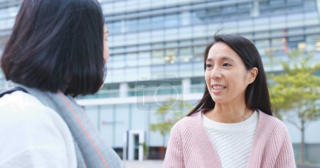 Two girl friends talk to each other