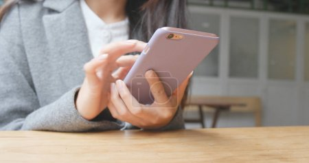 Photo for Woman using smartphone at outdoor - Royalty Free Image