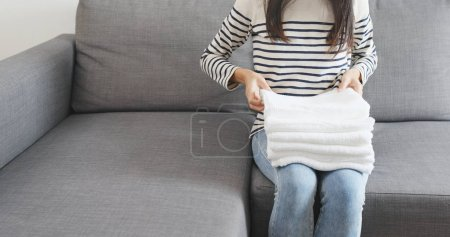 Housewife folding white towels