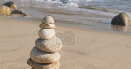 Zen stones on a beach coast