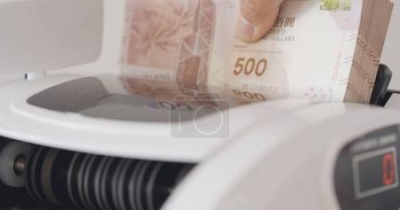 Money counting machine close up