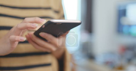 Photo for Woman using smartphone in hands - Royalty Free Image